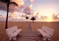 harbor beach benches at sunrise