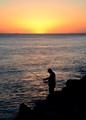 Man fishing off pier in Mission Beach, San Diego