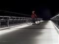 Bicylist on Pedestrian Bridge