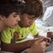 Boys playing on tablet (2)