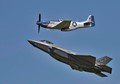 WW2 era P51 Mustang with the latest F35 climbs away after flying in formation.