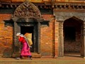 Woman carrying bricks in Durbar Square Palace