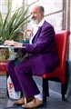 Man in a Purple Suit