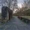 Dawn breaks behind an abstract sculture near Abbaye Neumunster