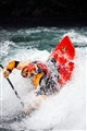Andrew Jobe dives into a hole in a whitewater kayak on the Kananaskis River, Alberta