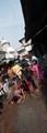 fighting against scorching summer heat ,paying obeisance,to Gods,Kalighat ,Kali temple,Kolkata,India.