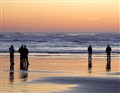Surf Watchers At Sunset