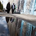 Palestinian passents water reflection