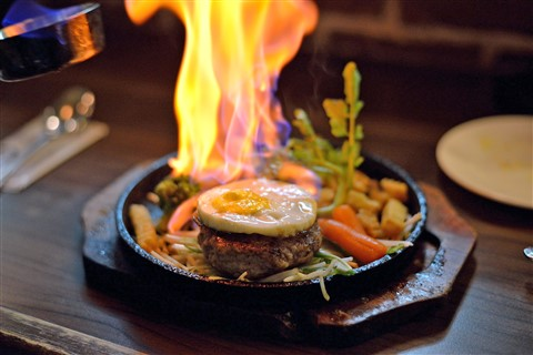 Flaming Hamburger steak at Ma Maison