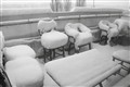 Winter snow on veranda furniture