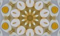 """A series of hard boiled eggs, shelled and cut in half made into a """"caleidoscope"""" pattern"""