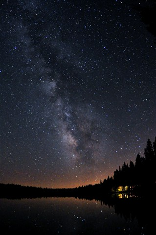 Cabin, lake, and Milky Way