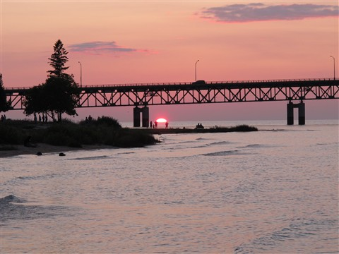 Sunset under Mackinac Bridge