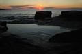Sunrise over rock pool