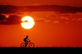 An amazing sunset and a biker...