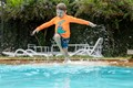 Grandson jumping into pool