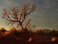 Uluru and tree at sunrise