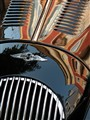 Reflection on a Morgan car.