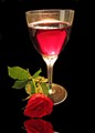 Red wine with a red rose