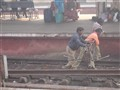 People carrying Rail road..