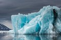 Some iceberg recently calved from tidewater glaciers show vivid blue and green colors. However, the coloring appears most strongly when the sky is overcast or the iceberg is in the shade.