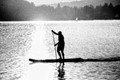 stand up paddling on an evening