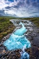 This is Bruarfoss located on the south coast of Iceland. One of the clearest waterfall you can find