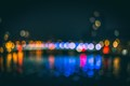 Bokeh balls from street lights and window lights show the outlines of a city bridge and office building in Liege Belgium