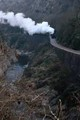 Steam train in river gorges