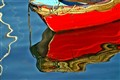 Red Skiff Reflections