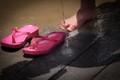 Pink flip flops on the beach