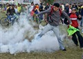 Kicking a tear gas canister.