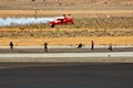 Lucas Oil plane flying inverted through a tape placed just above the runway. Taken at Reno Air Races, August 2016.
