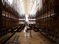 Interior of Winchester Cathedral, with a view past the choir stalls along the nave toward the main entrance. I don't think. the folding chairs in the foreground enhance the setting, but that's the way things were set up.