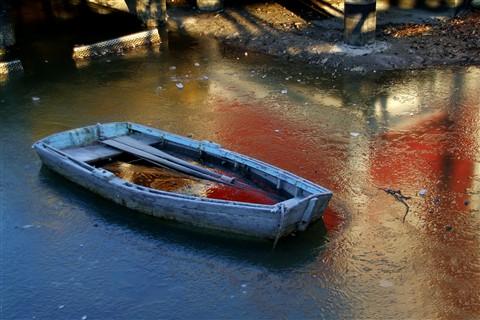 Frozen sunken boat