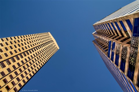 Up through the skyscrapers, into the blue sky