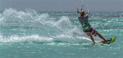 Kitesurfing Pushing Water into The Aruba Sunset