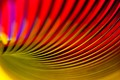 A slinky toy, Lightbox and coloured sweet wrapping papers.