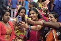 In an Indian Marriage party few ladies taking Selfies