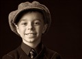 Boy with man's hat