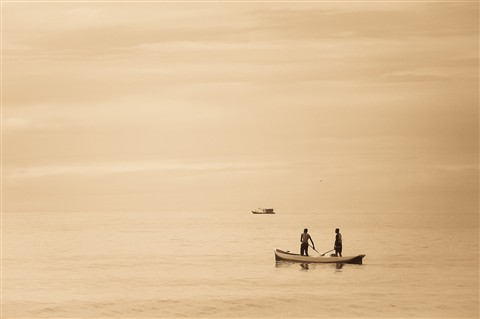 Fishermen in a dull day