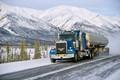 truck along alaska's dalton highway in winter