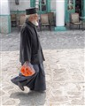 Greek Orthodox Priest with Oranges