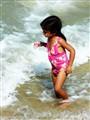 A brunette on the beach
