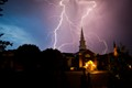 Lightning strike over a church.