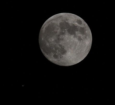 Satellite passes near the moon.