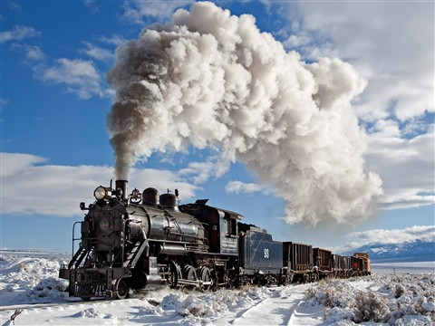 1909 Alco Pittsburgh built 2-8-0 locomotive hauling train on Nevada Northern Railroad