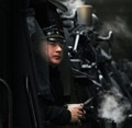 Steam train conducter in Berlin. The German railway offers many steam train rides every year...they are very popular and usually booked out.