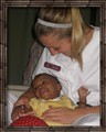 Luisa, SPT, with African Child