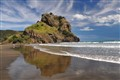 The beach and the Lion Rock at Piha, Auckland, New Zealand